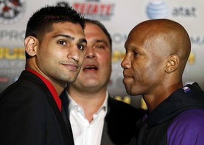 Амир Хан (слева), Getty Images