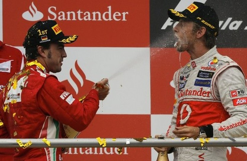 Алонсо и Баттон, Reuters