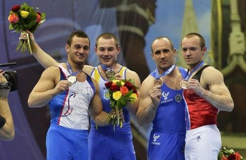 Игорь Радивилов и три других призера в упражнениях на кольцах, ueg.org