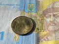 Гривна девальвировала к доллару на 0,6%