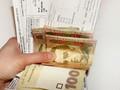 Меньше половины украинцев платят за коммунальные услуги по счетчикам